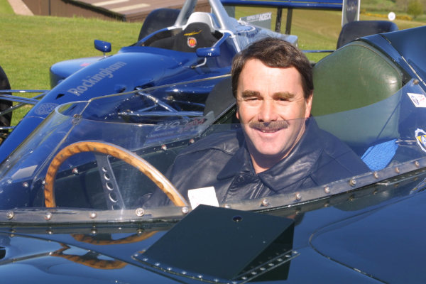 2001 Rockingham Mansell PreviewNigel Mansell sits in the Jaguar D Type of Mike Hawthorn from 1955, alongside the ChampCar which will race at Rockingham this year.Woodbury Country Park, Woodbury, Exeter. 8th May 2001.World Copyright - Rockinghamref: 8 9 MB Digital Image