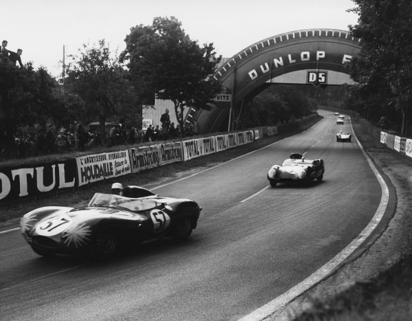 Le Mans, France. 21st - 22nd June 1958 Maurice Charles/John Young (Jaguar D-type), retired, leads Bill Frost/Bob Hicks (Lotus Eleven Climax), retired, action. World Copyright: LAT Photographic Ref: B/W Print.