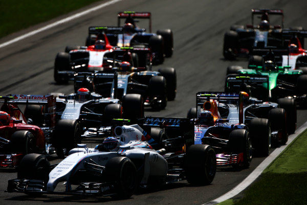 Autodromo Nazionale di Monza, Monza, Italy. Sunday 7 September 2014. Valtteri Bottas, Williams FW36 Mercedes, leads Daniel Ricciardo, Red Bull Racing RB10 Renault, Adrian Sutil, Sauber C33 Ferrari, and the remainder of the field in to the first chicane. World Copyright: Andy Hone/LAT Photographic. ref: Digital Image _ONY1987