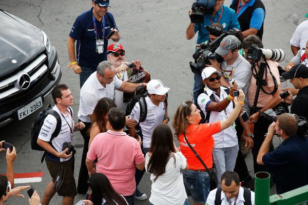 Interlagos, Sao Paulo, Brazil. Sunday 9 November 2014. Felipe Massa, Williams F1, poses for photos with fans. World Copyright: Charles Coates/LAT Photographic. ref: Digital Image _J5R5291