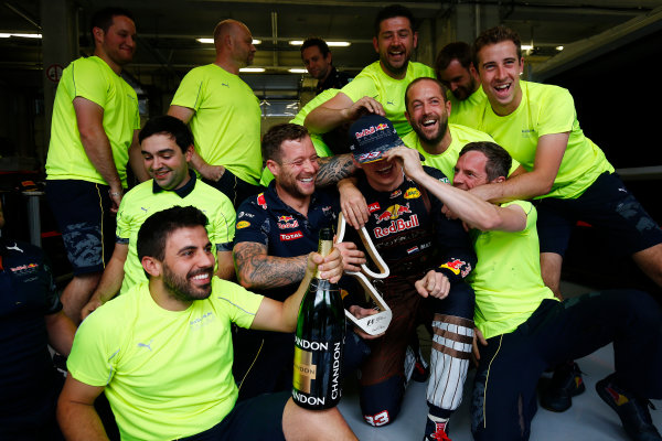 Red Bull Ring, Spielberg, Austria. Sunday 3 July 2016. Max Verstappen, Red Bull Racing, 2nd Position, and Red Bull team mates celebrate with his trophy. World Copyright: Andrew Hone/LAT Photographic ref: Digital Image _ONZ7879
