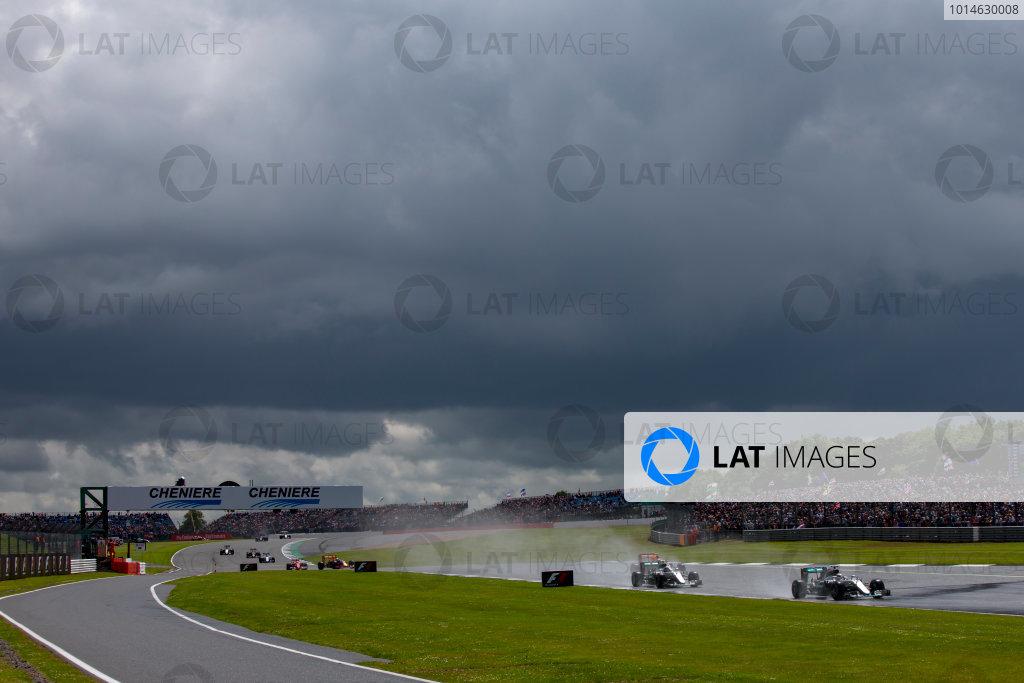 Silverstone, Northamptonshire, UK. Sunday 10 July 2016. Lewis Hamilton, Mercedes F1 W07 Hybrid, leads Nico Rosberg, Mercedes F1 W07 Hybrid and Max Verstappen, Red Bull Racing RB12 TAG Heuer.   World Copyright: Zak Mauger/LAT Photographic ref: Digital Image _79P8088