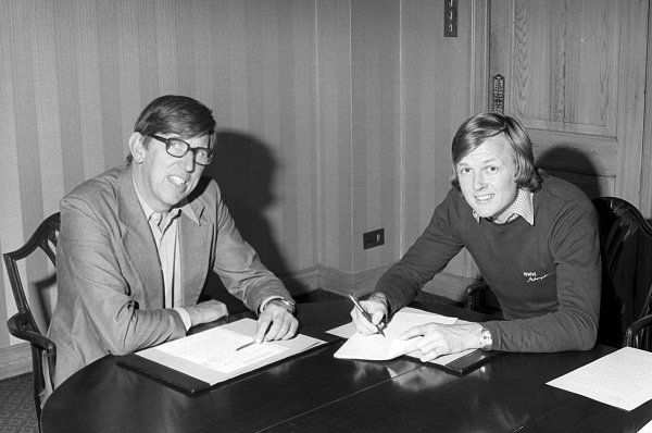 (L to R): Ken Tyrrell (GBR) Tyrrell Team Owner with Ronnie Peterson (SWE), who signed to drive with the team in 1977. Formula One World Championship, c. September 1976.