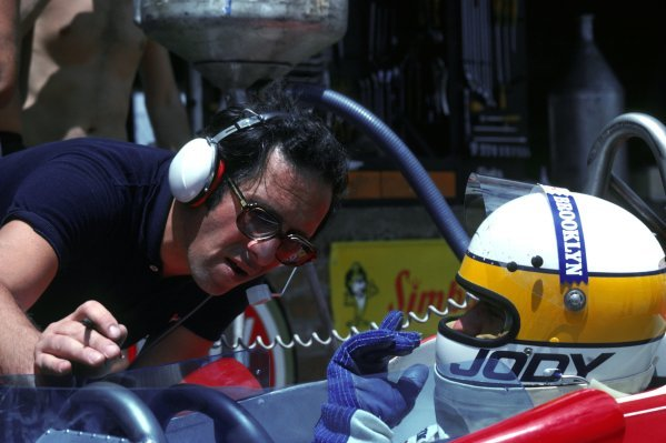 (L to R): Mauro Forghieri (ITA) Ferrari Designer talks with Jody Scheckter (RSA) Ferrari 312T4, who finished second in his home GP.