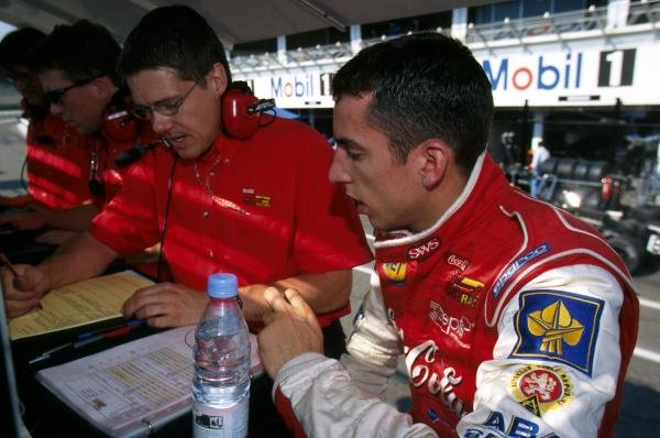 Second place finisher Justin Wilson (GBR) Nordic Racing discusses his car set-up with an engineer. 
