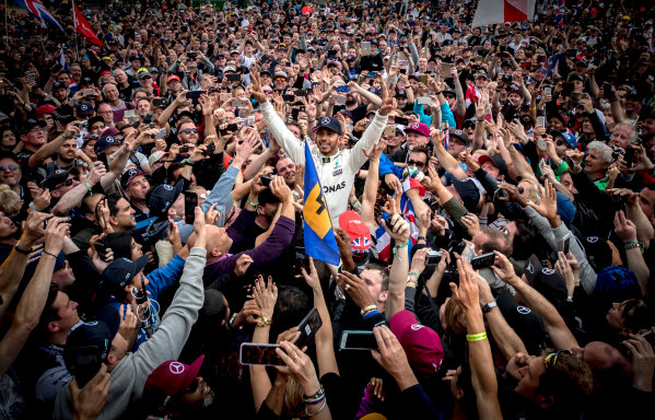 Silverstone, Northamptonshire, UK.  Sunday 16 July 2017. Lewis Hamilton, Mercedes AMG, 1st Position, celebrates victory with some crowd surfing. World Copyright: Dunbar/LAT Images  ref: Digital Image _X4I8864