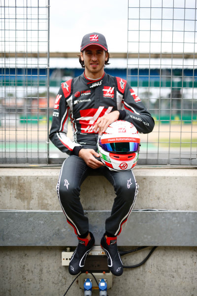 Silverstone, Northamptonshire, UK.  Thursday 13 July 2017. Antonio Giovinazzi, Ferrari, poses with his crash helmet. World Copyright: Andy Hone/LAT Images  ref: Digital Image _ONZ2885