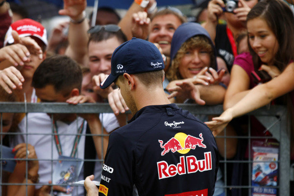 Hungaroring, Budapest, Hungary26th July 2012Sebastien Vettel, Red Bull Racing signs his autograph for fans.World Copyright:Charles Coates/LAT Photographicref: Digital Image _26Y9128
