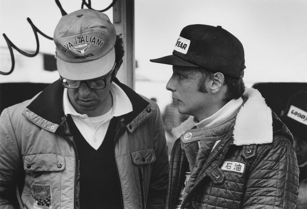 Watkins Glen, New York, USA. 8th - 10th October 1976. Niki Lauda (Ferrari 312T2), 3rd position in conversation with Mauro Forghieri, Technical Director of Ferrari, portrait. World Copyright: LAT Photographic.  Ref:  6871 - 8-8A.