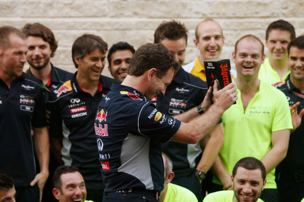 Circuit of the Americas, Austin, Texas, United States of America. Sunday 17th November 2013.  Christian Horner, Team Principal, Red Bull Racing, brings out some Jagermeister for the post race Red Bull celebrations. World Copyright: Alastair Staley/LAT Photographic. ref: Digital Image _R6T1128