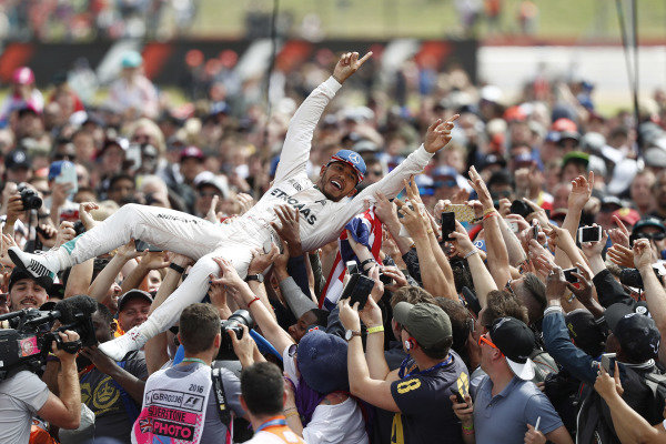 Silverstone, Northamptonshire, UK Sunday 10 July 2016. Lewis Hamilton, Mercedes AMG, 1st Position, celebrates with his home fans with a crowd surf. World Copyright: Dunbar/LAT Photographic ref: Digital Image _V2I1303