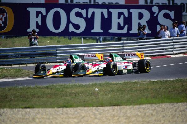 Alessandro Zanardi, Lotus 107B Ford, battles with teammate Johnny Herbert.