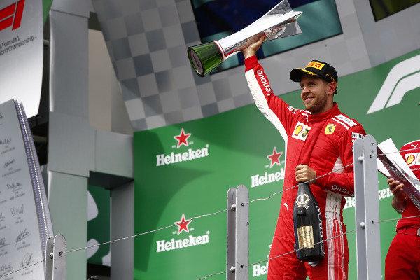 Sebastian Vettel, Ferrari, 1st position, celebrates on the podium.