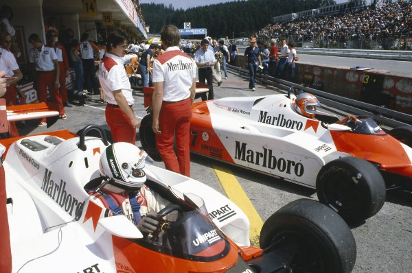 1981 Austrian Grand Prix.Osterreichring, Austria. 14-16 August 1981.Andrea de Cesaris and John Watson (McLaren MP4/1-Ford Cosworth) in the pits.World Copyright: LAT PhotographicRef: 35mm transparency 81AUT19