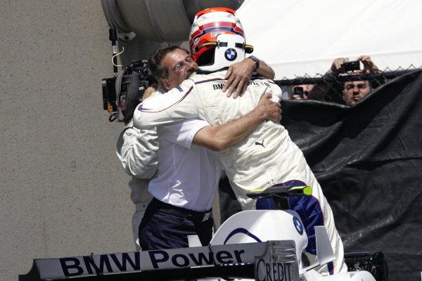 Dr Mario Theissen hugs winner Robert Kubica in parc ferme.