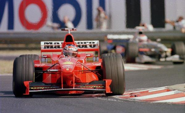 1998 Hungarian Grand Prix.Hungaroring, Budapest, Hungary.14-16 August 1998.Michael Schumacher (Ferrari F300).World Copyright - Steve Etherington/LAT Photographic