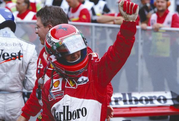 1999 Austrian Grand Prix.A1 Ring, Zeltweg, Austria.23-25 July 1999.Eddie Irvine (Ferrari) celebrates his 1st position in parc ferme. Ross Brawn stands behind.Ref-99 AUT 71.World Copyright - LAT Photographic