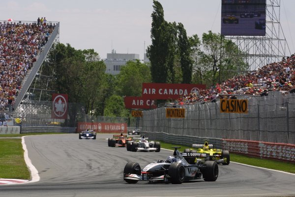 2001 Canadian Grand Prix - RACEMontreal, Canada. 10th June 2001.David Coulthard leads Jarno Trulli, Olivier Panis and Jos Verstappen.World Copyright - LAT PhotographicRef: 8 9 MB Digital File Only