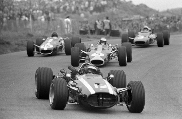 Jochen Rindt, Cooper T81B Maserati leads Jim Clark, Lotus 49 Ford and Dan Gurney, Eagle T1G Weslake.