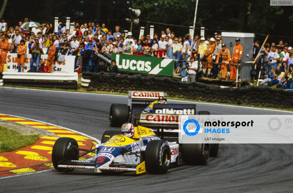 Nigel Mansell, Williams FW11 Honda, leads Riccardo Patrese, Brabham BT54 BMW, and Nelson Piquet, Williams FW11 Honda.