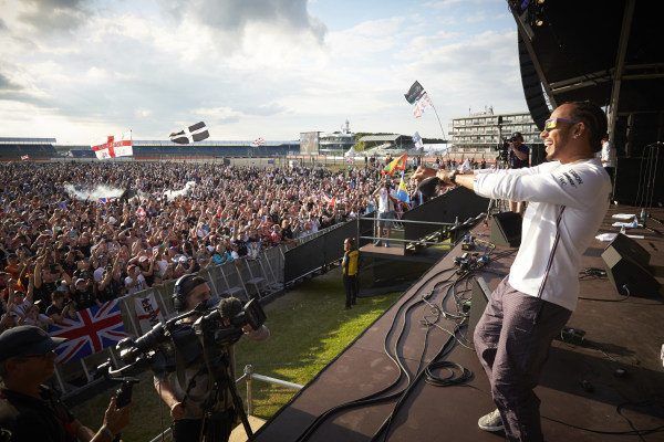Lewis Hamilton, Mercedes AMG F1, 1st position, celebrates with fans, from the stage