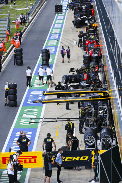 Teams prepare for the F2 race in the pit lane