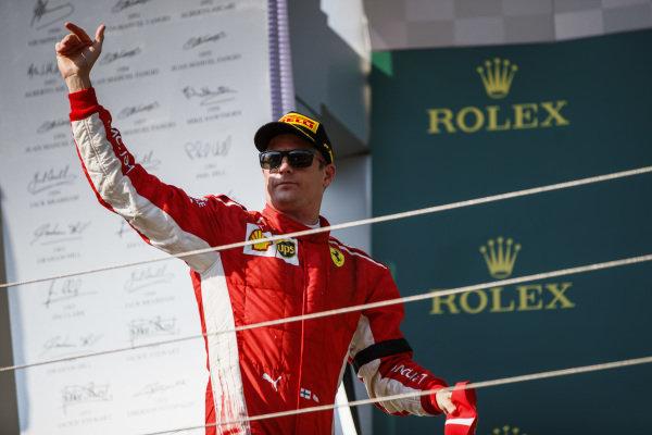 Kimi Raikkonen, Ferrari on podium.