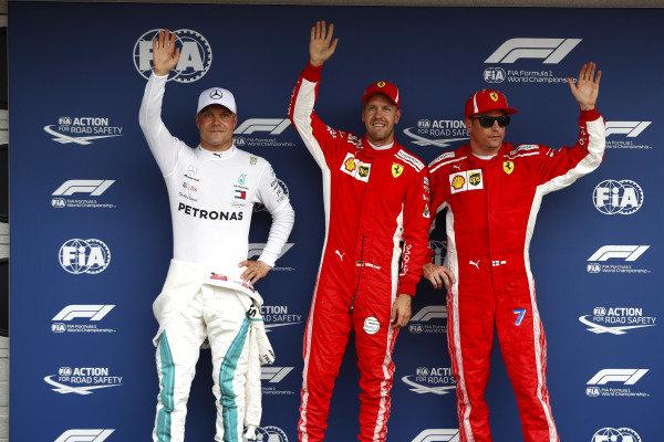Pole man Sebastian Vettel, Ferrari, celebrates alongside Valtteri Bottas, Mercedes AMG F1, and Kimi Raikkonen, Ferrari.