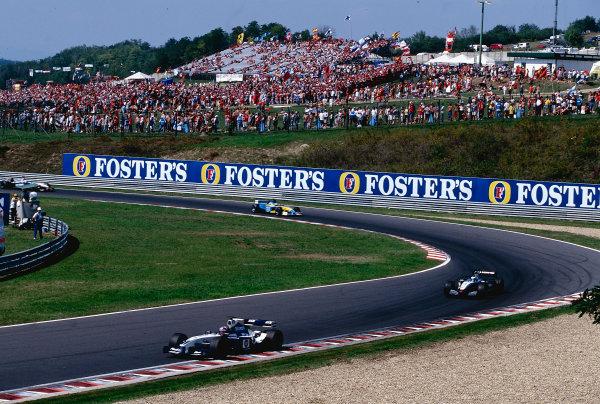 2002 Hungarian Grand Prix.Hungaroring, Budapest, Hungary. 16-18 August 2002.Juan-Pablo Montoya (Williams FW24 BMW) followed by Kimi Raikkonen (McLaren MP4/17 Mercedes) Ref-02 HUN 19.World Copyright - PICME/LAT Photographic