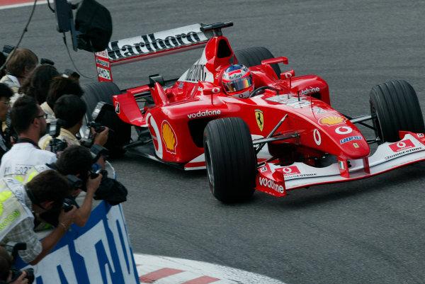 2002 Belgian Grand Prix - PracticeSpa-Francorchamps, Belgium. 30th August 2002.Rubens Barrichello (Ferrari F2002) at La Source Hairpin.World Copyright - LAT Photographicref: digital file only