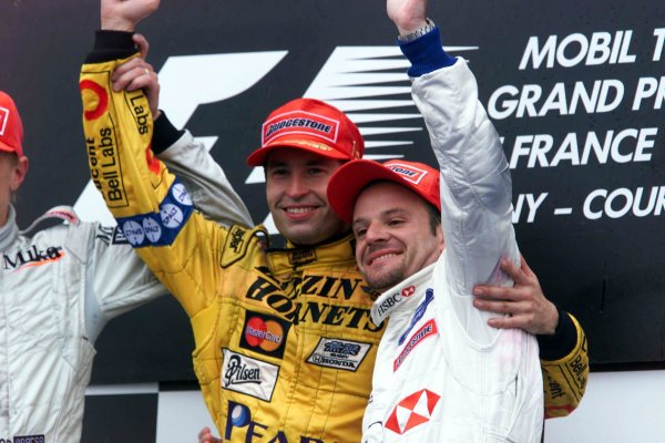 1999 French Grand Prix.Magny-Cours, France.25-27 June 1999. Heinz-Harald Frentzen (Jordan Mugen Honda) celebrates his 1st position on the podium, with Rubens Barrichello (Stewart Ford) 3rd position.World Copyright - Lawrence/LAT Photographic