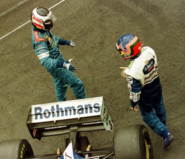 1997 Brazilian Grand Prix.Interlagos, Sao Paulo, Brazil.28-30 March 1997.Jacques Villeneuve (Williams Renault) and Gerhard Berger (Benetton Renault) congratulate each other after finishing in 1st and 2nd positions respectively.World Copyright - LAT Photographic