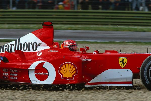 2002 San Marino Grand Prix.Imola, Italy.12-14 April 2002.Michael Schumacher (Ferrari F2002) takes a trip through the gravel in practice.Ref-02 SM 37.World Copyright - LAT Photographic