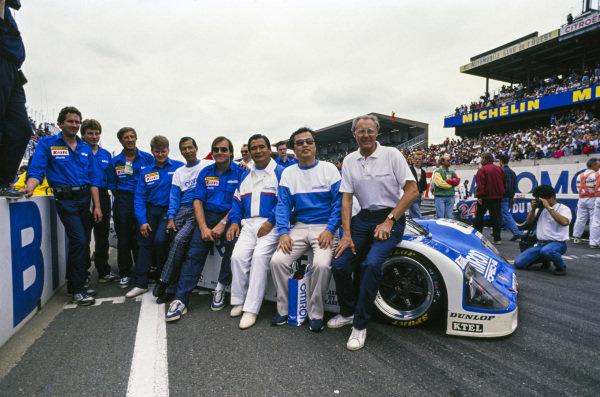 A Team Schuppan photo shoot with their Porsche 962 C on the grid.