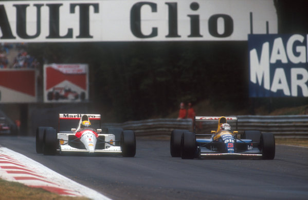 1991 Italian Grand Prix.Monza, Italy.6-8 September 1991.Nigel Mansell (Williams FW14 Renault) overtakes Ayrton Senna (McLaren MP4/6 Honda) for the lead. They finished in 1st and 2nd positions respectively.Ref-91 ITA 22.World Copyright - LAT Photographic