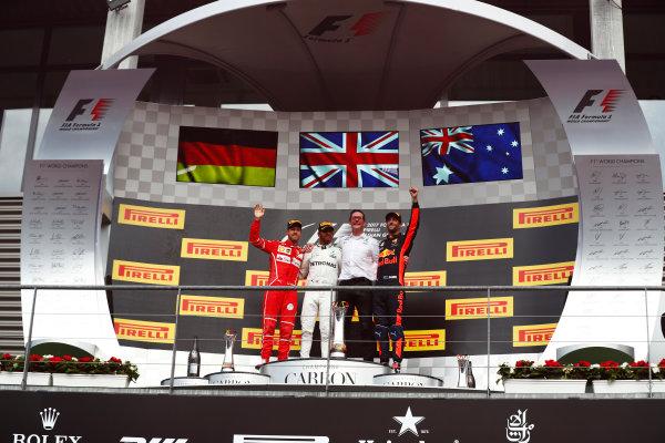 Spa Francorchamps, Belgium.  Sunday 27 August 2017. Lewis Hamilton, Mercedes AMG, celebrates on the podium with Sebastian Vettel, Ferrari, and Daniel Ricciardo, Red Bull Racing.  World Copyright: Sam Bloxham/LAT Images  ref: Digital Image _J6I0261