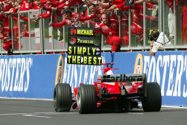 2004 Belgian Grand Prix - Sunday Race,Spa-Francorchamps, Belgium. 29th August 2004 The Ferrari team celebrate as Michael Schumacher, Ferrari F2004, finishes in 2nd position Also clinching his 7th Drivers World Championship title.World Copyright: Steve Etherington/LAT Photographic ref: Digital Image Only