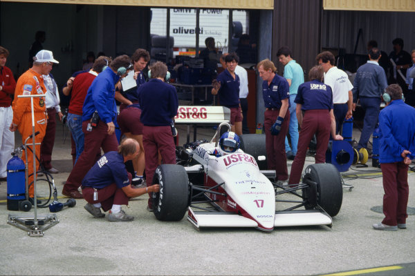 Silverstone, England. 10 - 12 July 1987.Derek Warwick (Arrows A10-Megatron), retired, Chief Designer, Ross Brawn overlooks the action in the pits, portrait.World Copyright: LAT Photographic.Ref: 35mm Colour Transparency