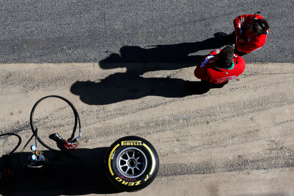 2016 GP2 Series Test 1. Circuit de Catalunya, Barcelona, Spain. Friday 11 March 2016. PREMA Racing engineers in the pit lane next to a pirelli tyre and wheel guns World Copyright: Sam Bloxham/LAT Photographic. ref: Digital Image _R6T9163