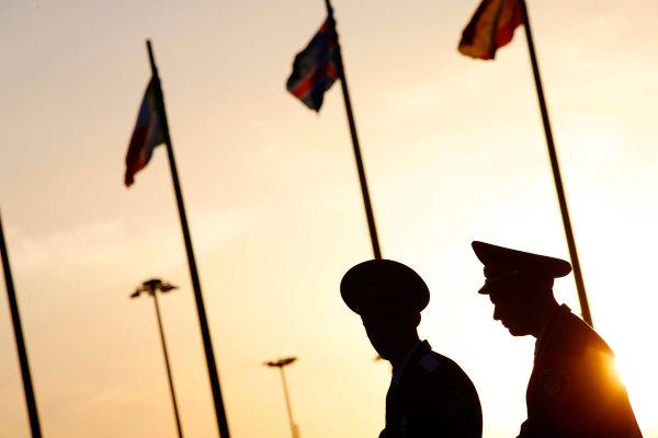 Sochi Autodrom, Sochi, Russia. Sunday 12 October 2014. Russian security at sun set. World Copyright: Charles Coates/LAT Photographic. ref: Digital Image _J5R4093