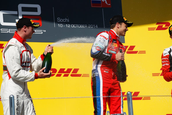 2014 GP3 Series. Round 8.   Sochi Autodrom, Sochi, Russia. Sunday Race 2 Sunday 12 October 2014. Dean Stoneman (GBR, Marussia Manor Racing) and Patric Niederhauser (SUI, Arden International) spray the champagne on the podium. Photo: Sam Bloxham/GP3 Series Media Service. ref: Digital Image _G7C7718