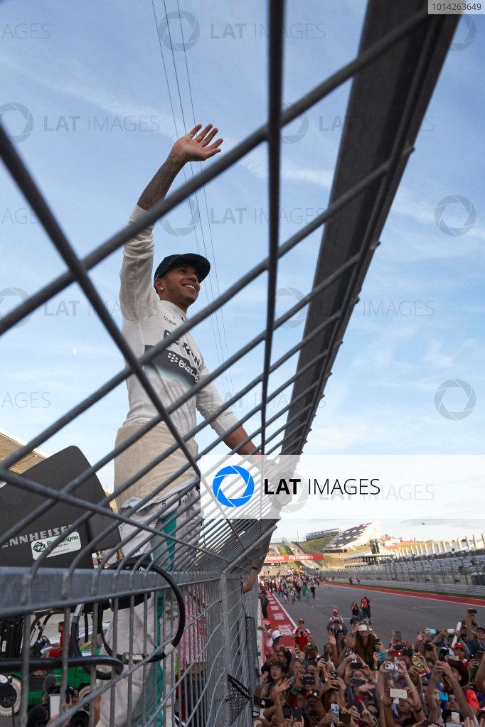 Circuit of the Americas, Austin, Texas, United States of America. Sunday 2 November 2014. Lewis Hamilton, Mercedes AMG celebrates on the fence after winning the race. World Copyright: Steve Etherington/LAT Photographic. ref: Digital Image SNE10577