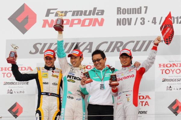 Suzuka Circuit, Japan. Rd 7 - 3rd - 4th November 2012. Race 2 Winner Kazuki Nakajima ( #2 PETRONAS TEAM TOM'S ) 2nd position Loic Duval ( #8 Team KYGNUS SUNOCO )  3rd position Koudai Tsukakoshi ( #41 DOCOMO TEAM DANDELION RACING ) podium, portrait. World Copyright: Yasushi Ishihara/LAT Photographic ref: Digital Image 2012FN_Rd7_023