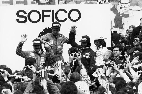 1974 Spanish Grand Prix.Jarama, Madrid, Spain. 26 - 28 April 1974.Niki Lauda (Ferrari 312B3) 1st position, Clay Regazzoni (Ferrari 312B3) 2nd position and Emerson Fittipaldi (McLaren M23) 3rd position, podium.World Copyright - LAT Photographicref: b/w print