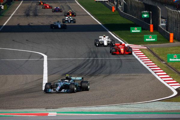 Valtteri Bottas, Mercedes AMG F1 W09, leads Sebastian Vettel, Ferrari SF71H, Charles Leclerc, Sauber C37 Ferrari, Marcus Ericsson, Sauber C37 Ferrari, and Lewis Hamilton, Mercedes AMG F1 W09.