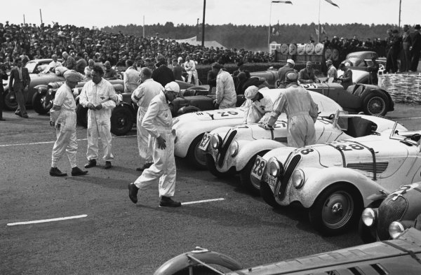 Le Mans, France. 18th June 1939.Cars line up in the paddock before the start of the raece. Here two BMW 328 are lined up next to a BMW 328 Touring Coupe, action. World Copyright: LAT Photographic.