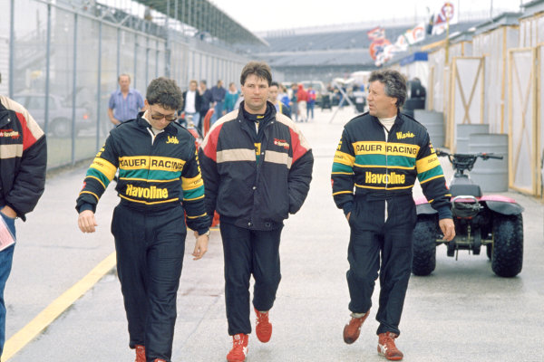 Daytona 24 Hours, Florida, USA. 2nd - 3rd February 1991. Rd 1. Left to Right: Jeff Andretti, Michael Andretti and Mario Andretti walk through the paddock, portrait. World Copyright: Bill Murenbeeld/LAT Photographic. Ref: 91IMSA DAY01.