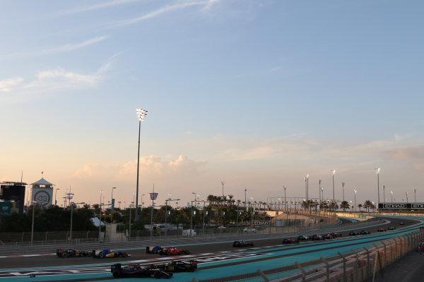 Yas Marina Circuit, Abu Dhabi, United Arab Emirates. Sunday 29 November 2015. Fernando Alonso, McLaren MP4-30 Honda, and Pastor Maldonado, Lotus E23 Mercedes, tangle round the first corner. World Copyright: Will Taylor-Medhurst/LAT Photographic ref: Digital Image 267A9940