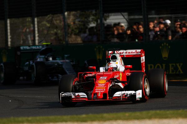 Albert Park, Melbourne, Australia. Sunday 20 March 2016. Sebastian Vettel, Ferrari SF16-H leads Nico Rosberg, Mercedes F1 W07 Hybrid. World Copyright: Sam Bloxham/LAT Photographic ref: Digital Image _R6T3739