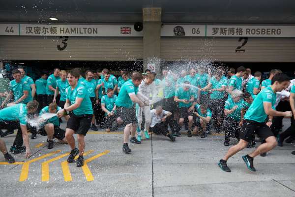 Shanghai International Circuit, Shanghai, China. Sunday 17 April 2016. Nico Rosberg, Mercedes AMG, 1st Position, Tony Ross, Race Engineer, Mercedes AMG, and the Mercedes team celebrate victory after the race. World Copyright: Steve Etherington/LAT Photographic ref: Digital Image SNE12654